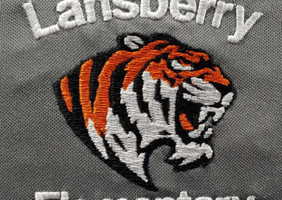 School spirit-wear logo embroidered on a polyester polo